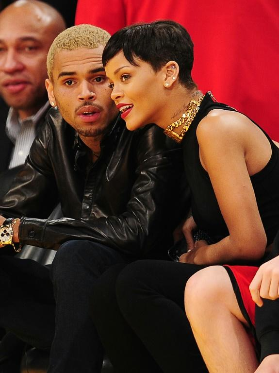 Rihanna (R) and Chris Brown attend an NBA game in 2012