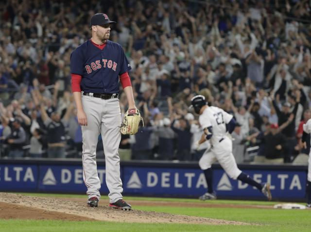 Boston Red Sox relief pitcher Heath Hembree waits as New York Yankees' Giancarlo Stanton runs the bases after hitting a grand slam during the fourth inning of a baseball game Thursday, Sept. 20, 2018, in New York. (AP Photo/Frank Franklin II)