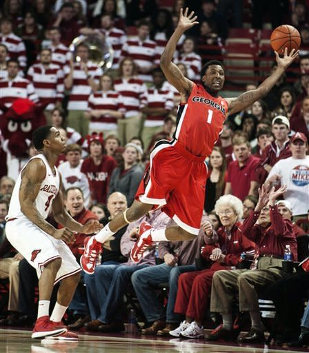 Georgia's Kentavious Caldwell-Pope (1) tries to save the ball from going out of bounds as Arkansas' Coty Clarke (4) watches during the first half of an NCAA college basketball game in Fayetteville, Ark., Thursday, Feb. 21, 2013. (AP Photo/April L. Brown)