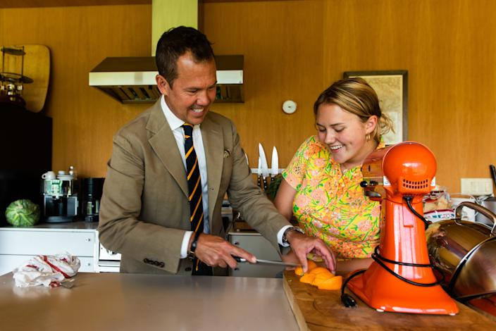 Magazine editor Matt Hranek, left, and his daughter Clara Hranek, right, cut an orange slice to garnish a Negroni at his home in Hankins, NY on Friday, August 22nd, 2020.