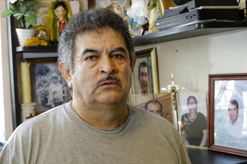 """In this Thursday, June 4, 2020, photo, Francisco Flores poses for a portrait in New York. When his brother Crescencio Flores died of coronavirus in New York, his parents back in Mexico asked for one thing: that their son be sent home for burial. So far, his efforts have been in vain. """"I am trying to do this because my parents, 85 and 87 years old, live there,"""" Francisco Flores said. """"They are rooted in their customs. They want a Christian burial for the remains of their son."""" (AP Photo/Frank Franklin II)"""