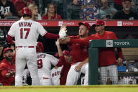 Los Angeles Angels' Shohei Ohtani (17) is met in the dugout by Mike Trout, center, and bench coach Mike Gallego, right, during the sixth inning of a baseball game against the Houston Astros Tuesday, Sept. 21, 2021, in Anaheim, Calif. (AP Photo/Marcio Jose Sanchez)