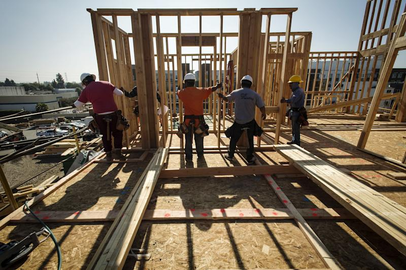 Contractors work on townhouses under construction at the PulteGroup Inc. Metro housing development in Milpitas, California.