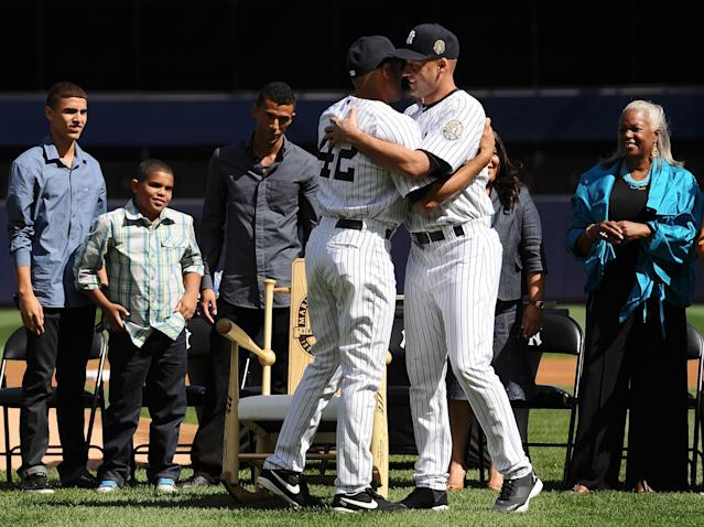 NEW YORK, NY - SEPTEMBER 22: Mariano Rivera #42 of the New York Yankees hugs his teammate Derek Jeter #2 during the Mariano Rivera Day pregame ceremony on September 22, 2013 at Yankee Stadium in the Bronx borough of New York City. (Photo by Maddie Meyer/Getty Images)