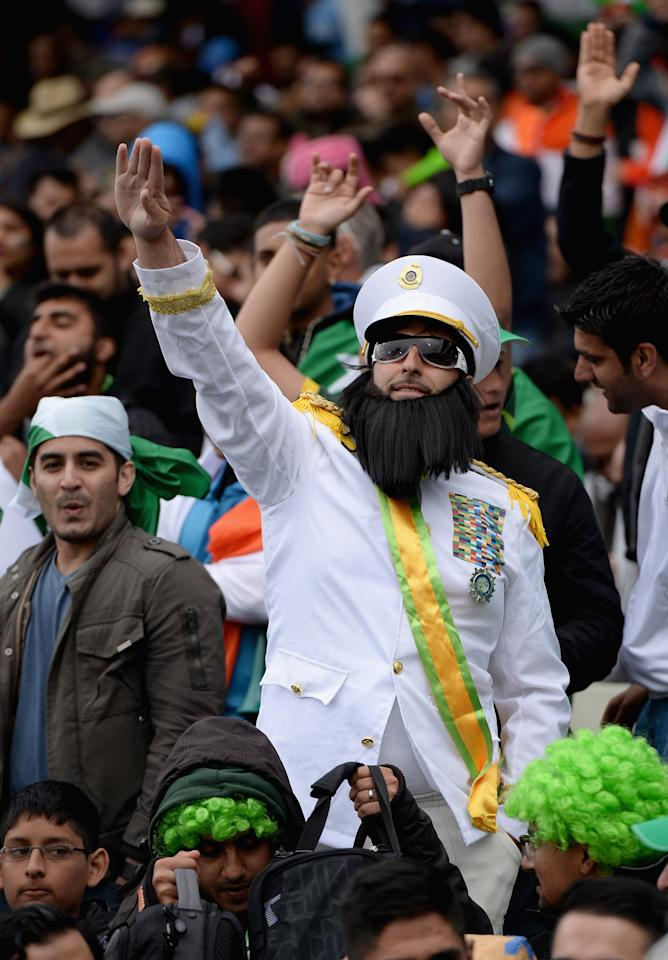 BIRMINGHAM, ENGLAND - JUNE 15:  Pakistan fans cheer during the ICC Champions Trophy match between India and Pakiatan at Edgbaston on June 15, 2013 in Birmingham, England.  (Photo by Gareth Copley/Getty Images)