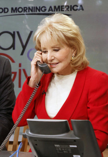 """This image released by American Broadcasting Companies shows Barbara Walters answering a phone to take donations for victims of Hurricane Sandy during """"Good Morning America,"""" Monday, Nov. 5, 2012 in New York. Walters made a contribution of $250,000 to the American Red Cross and GMA co-host George Stephanopoulos followed suit with a donation for $50,000. (AP Photo/American Broadcasting Companies, Lou Rocco)"""