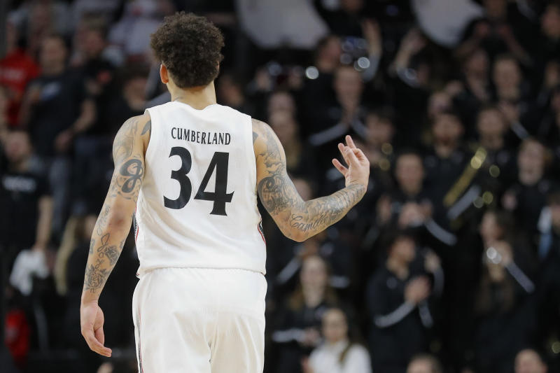 Cincinnati's Jarron Cumberland reacts after making a 3-point shot during the second half of the team's NCAA college basketball game against SMU, Tuesday, Jan. 28, 2020, in Cincinnati. (AP Photo/John Minchillo)