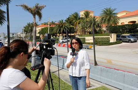 A Voice of America crew reports in front of the  Eau Palm Beach Resort and Spa where President of China Xi Jinping will stay in Manalapan, Florida U.S., April 5, 2017. U.S. President Donald Trump will meet with Xi Jinping on April 6 and 7 at his nearby Mar-a-Lago estate. REUTERS/Joe Skipper