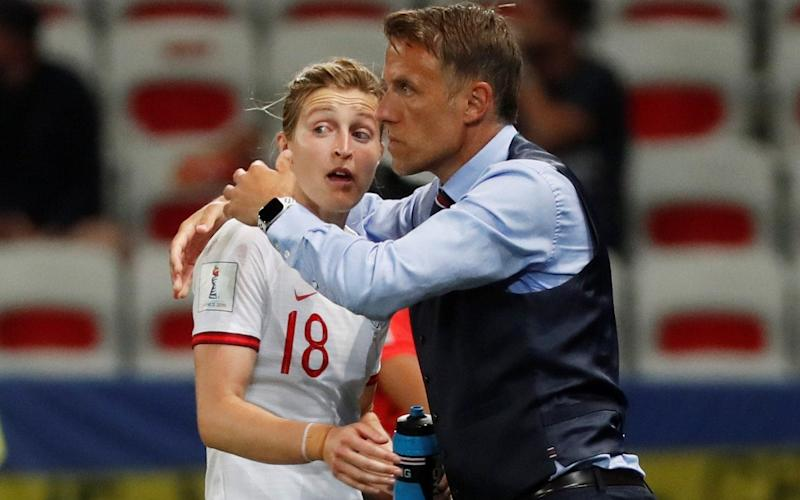 England's Ellen White celebrates scoring their second goal with England manager Phil Neville - REUTERS