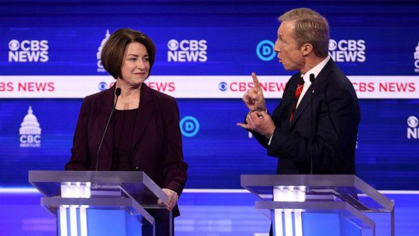 PHOTO: Democratic presidential candidate Tom Steyer speaks as Sen. Amy Klobuchar reacts during the Democratic presidential primary debate at the Charleston Gaillard Center, Feb. 25, 2020, in Charleston, South Carolina. (Win Mcnamee/Getty Images)