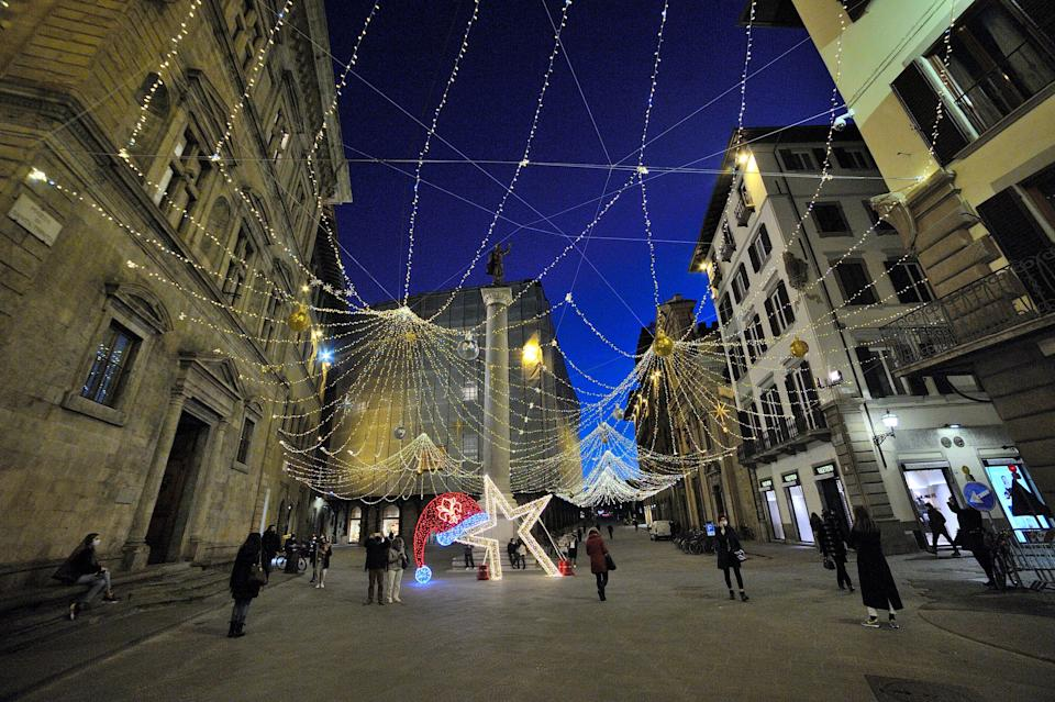 FLORENCE, ITALY - NOVEMBER 24: Via Tornabuoni, the most famous Florentine shopping street with the shops partially closed for the red zone, turns on the lights for the Christmas holidays on November 24, 2020 in Florence, Italy. While the whole country is in lockdown of varying degrees between regions, the contagions seems to be dropping. (Photo by Paolo Lo Debole/Getty Images) (Photo: Paolo Lo Debole via Getty Images)
