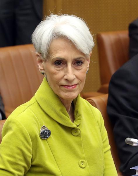 U.S. Undersecretary of State for Political Affairs Wendy Sherman waits for the start of closed-door nuclear talks in Vienna, Austria, Tuesday, March 18, 2014. Iran's foreign minister Mohamad Javad Zarif and the EU's top foreign policy chief Catherine Ashton have launched a new round of nuclear talks between Tehran and six world powers, putting a reported tiff behind them. The two sides hope to reach an agreement by July that trims Iran's nuclear activities in exchange for an end to sanctions choking Tehran's economy. (AP Photo/Ronald Zak)