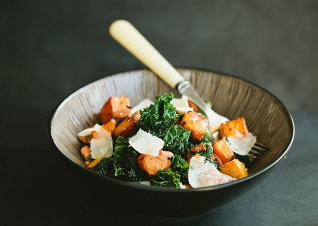 """An autumnal dish we'd happily eat all year long. <a href=""""https://www.bonappetit.com/recipe/kale-salad-with-butternut-squash-and-almonds?mbid=synd_yahoo_rss"""" rel=""""nofollow noopener"""" target=""""_blank"""" data-ylk=""""slk:See recipe."""" class=""""link rapid-noclick-resp"""">See recipe.</a>"""