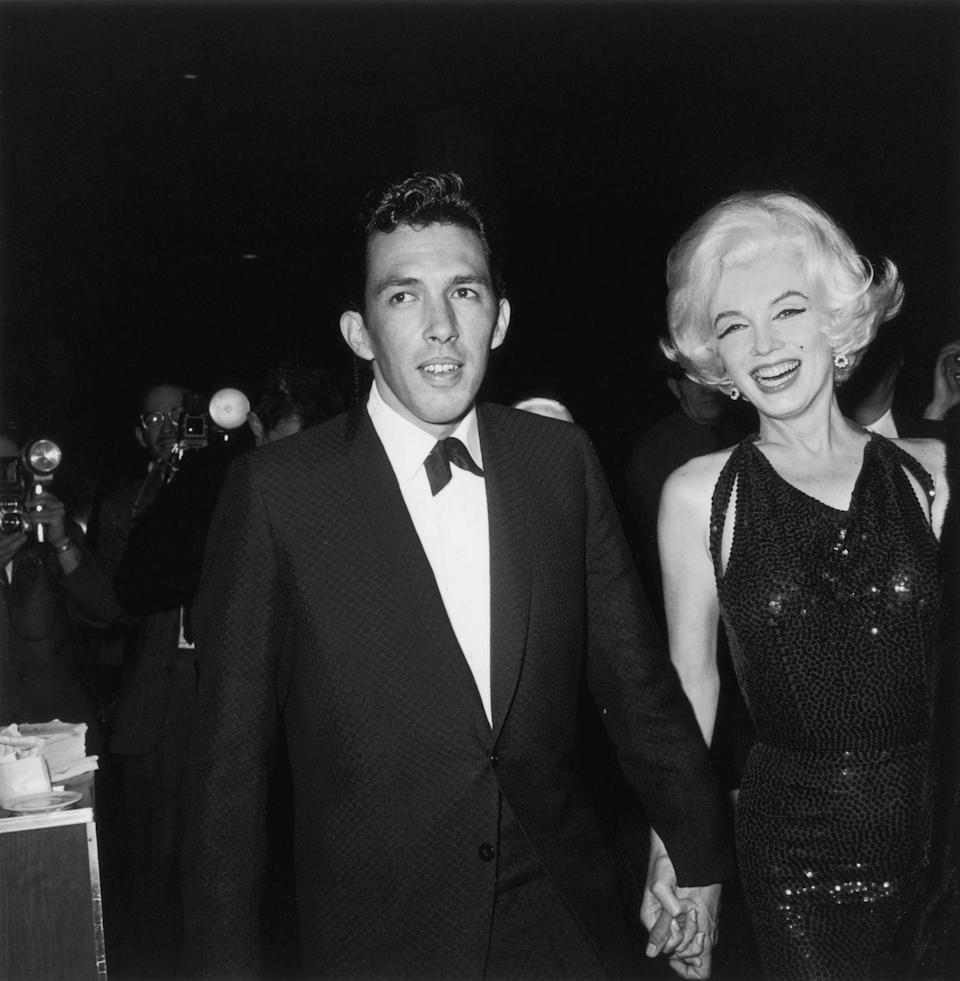 <p>Marilyn Monroe and writer Jose Bolanos arrive at the 1962 Golden Globe Awards in Hollywood. </p>