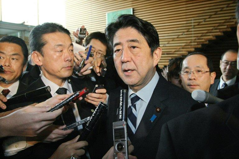 Japan's Prime Minister Shinzo Abe speaks with the press at the prime minister's residence in Tokyo on February 12, 2012