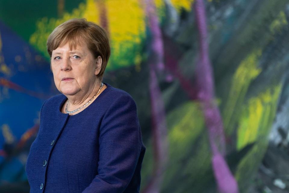 BERLIN, GERMANY - MARCH 13: German Chancellor Angela Merkel walks to a press statement prior to meeting with economic and labor unions leaders at the Chancellery on March 13, 2020 in Berlin, Germany. The meeting is taking place as the government prepares further measures to buffer the economy against the effects of the coronavirus epidemic. The number of confirmed cases in Germany has topped 2,700 with a heavy impact on public life becoming more and more apparent. (Photo by Hayoung Jeon - Pool / Getty Images)