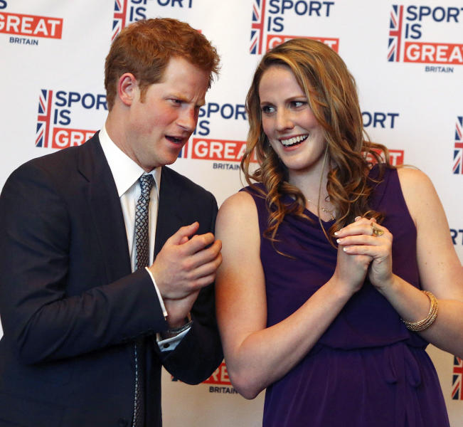 FILE- In this Friday, May 10, 2013, file photo, Britain's Prince Harry talks with Olympic gold medalist Missy Franklin at a reception at the Sanctuary Golf Course in Sedalia, Colo., south of Denver. What a senior year for Franklin! Went to the prom, two proms actually. Won a state title. Now, she'll walk down the aisle, She'll graduate from high school on Monday and start getting ready for college. (AP Photo/Ed Andrieski, File)