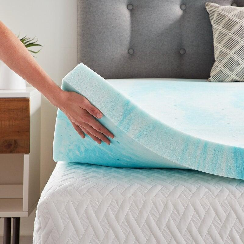 """<h2>63% Off LucidComfortCollection Swirl 3"""" Gel Memory Foam Mattress Topper</h2><br><strong>4.6 out of 5 stars and 1,726 reviews </strong><br>""""This is better than I ever expected. Since it's gel it doesn't get hot, allowing for a temperature-regulated sleep. The 2.5"""" is a perfect depth because it's squishy enough to cradle your body, yet not too squishy where you have problems turning over in the middle of the night. Highly recommend."""" –<em> Wayfair Reviewer</em><br><br><em>Shop <strong><a href=""""https://www.wayfair.com/bed-bath/pdp/lucid-comfort-collection-swirl-3-gel-memory-foam-mattress-topper-w003091991.html"""" rel=""""nofollow noopener"""" target=""""_blank"""" data-ylk=""""slk:Wayfair"""" class=""""link rapid-noclick-resp"""">Wayfair</a></strong></em><br><br><strong>Lucid Comfort Collection</strong> Swirl 3"""" Gel Memory Foam Mattress Topper, $, available at <a href=""""https://go.skimresources.com/?id=30283X879131&url=https%3A%2F%2Fwww.wayfair.com%2Fbed-bath%2Fpdp%2Flucid-comfort-collection-swirl-3-gel-memory-foam-mattress-topper-w003091991.html"""" rel=""""nofollow noopener"""" target=""""_blank"""" data-ylk=""""slk:Wayfair"""" class=""""link rapid-noclick-resp"""">Wayfair</a>"""