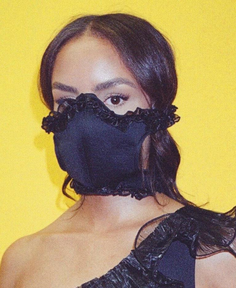 "Whether paired with cat ears or a witch hat, this ruffly mask deserves a spot on your Halloween style lineup. If you're branching out from all-black this year, go even bolder and opt for the bright orange or pink version. $45, Tia Adeola. <a href=""https://www.tiaadeola.com/shop/black-ruffle-face-mask"" rel=""nofollow noopener"" target=""_blank"" data-ylk=""slk:Get it now!"" class=""link rapid-noclick-resp"">Get it now!</a>"