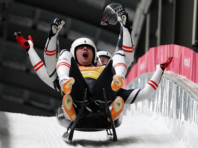 Luge - Pyeongchang 2018 Winter Olympic Games - Team Relay - Pyeongchang, South Korea - February 15, 2018 - Peter Penz and Georg Fischler of Austria celebrate. REUTERS/Edgar Su TPX IMAGES OF THE DAY