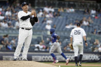 New York Yankees pitcher Nestor Cortes Jr., left, reacts after giving up a three-run home run to Texas Rangers' Delino DeShields during the eighth inning of a baseball game Monday, Sept. 2, 2019, in New York. (AP Photo/Adam Hunger)