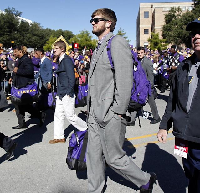 LSU quarterback Zach Mettenberger (8) arrives at Tiger Stadium before the start of an NCAA college football game against Arkansas in Baton Rouge, La., Friday, Nov. 29, 2013. (AP Photo/Bill Haber)