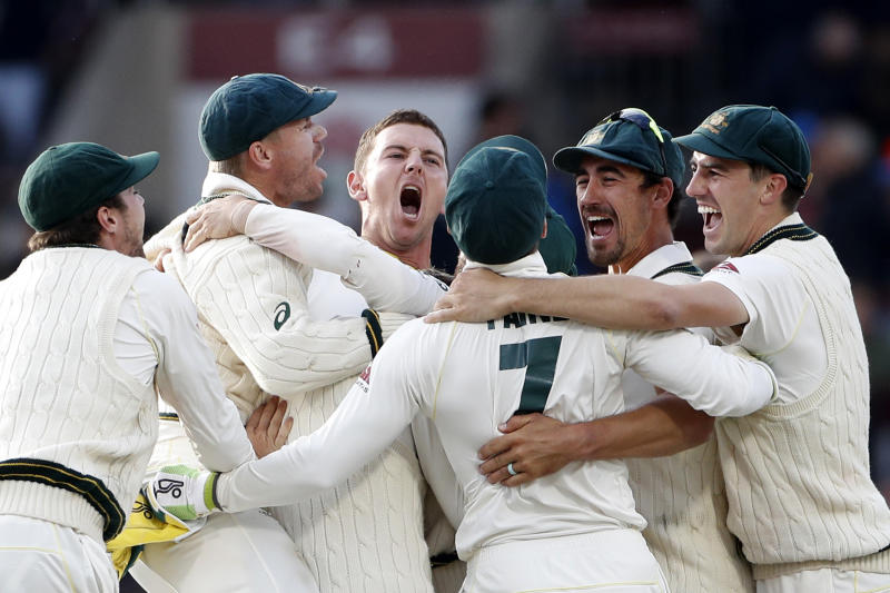 Australia players celebrate after winning the fourth test and retaining the Ashes during day five of the fourth Ashes Test cricket match between England and Australia at Old Trafford in Manchester, England, Sunday Sept. 8, 2019. (AP Photo/Rui Vieira)