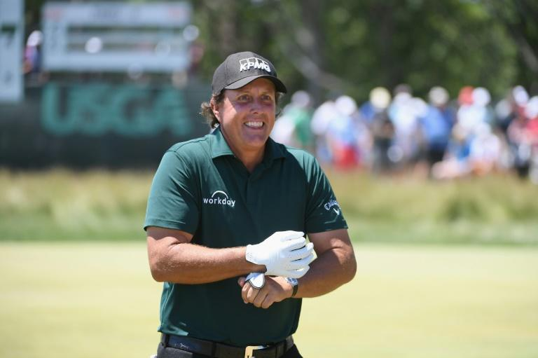 Phil Mickelson said he batted a still moving ball back toward the hole because the two-stroke penalty he knew he would receive would be preferable to letting the ball escape off the green