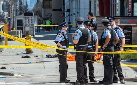 <span>Police in Toronto during the aftermath</span> <span>Credit: Zumapress </span>