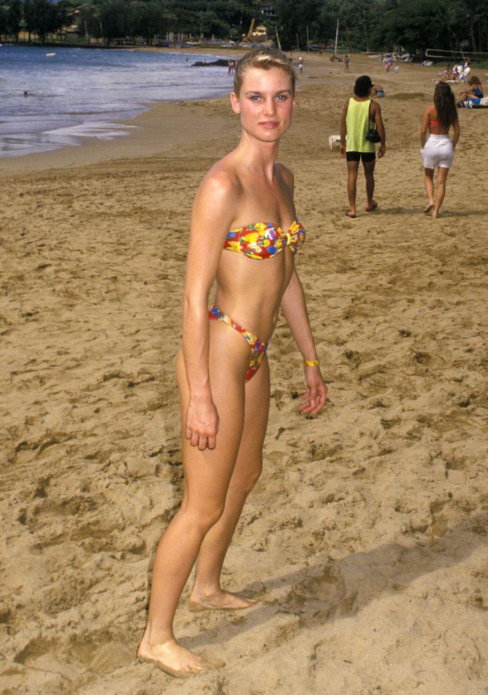 <p>By 1988 one-pieces were out of favor, and two-pieces were very much à la mode - particularly bandeau-style bikini tops with high-cut bottoms, as Nicolette Sheridan illustrates here.</p>