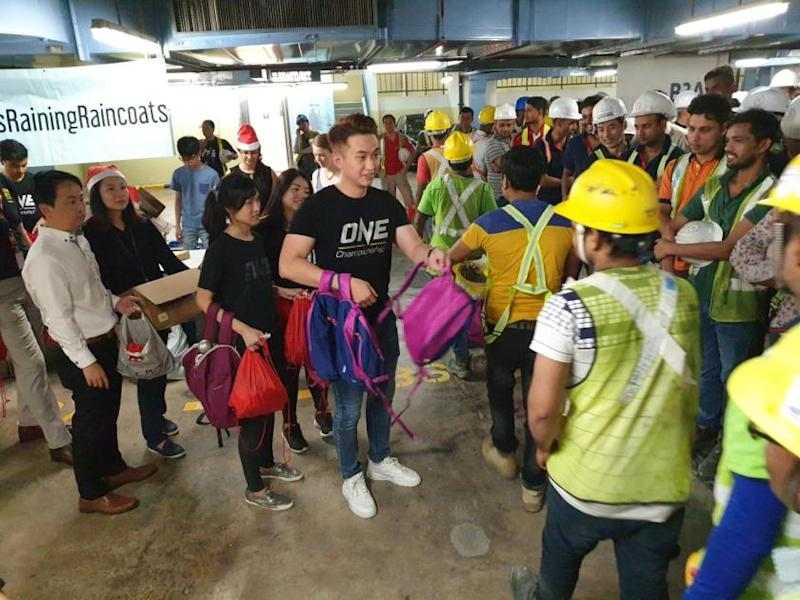 ONE Championship representatives hand out supplies to migrant workers in Singapore