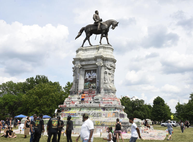 People gather around the statue of Confederate General Robert E. Lee in Richmond, Va.(Vivien Killilea/Getty Images)