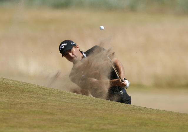 Kevin Kisner holds the lead after one day at the British Open. (AP)