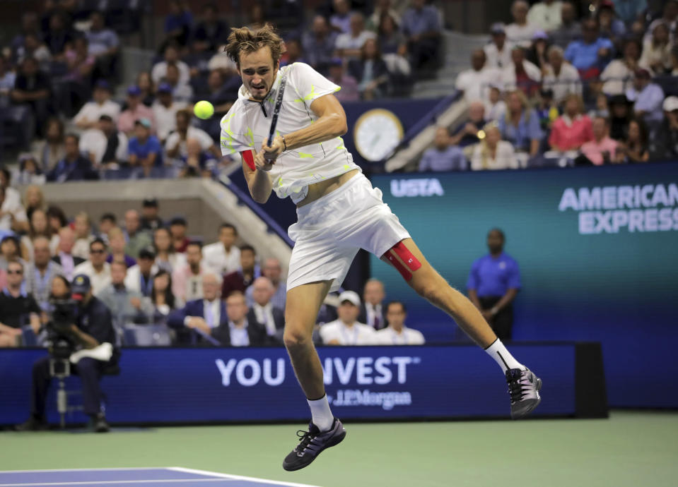 Daniil Medvedev, of Russia, returns a shot to Rafael Nadal, of Spain, during the men's singles final of the U.S. Open tennis championships Sunday, Sept. 8, 2019, in New York. (AP Photo/Charles Krupa)