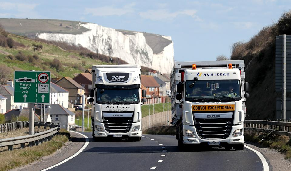 Lorries drive up A20 in Kent after arriving at the Port of Dover. Hauliers travelling to England from outside the UK for visits lasting more than two days will be tested for coronavirus from April 6. Hauliers, including drivers and crew of heavy goods vehicles and vans, will need to be tested within 48 hours of arriving and then every three days. Picture date: Tuesday April 6, 2021. (Photo by Gareth Fuller/PA Images via Getty Images)