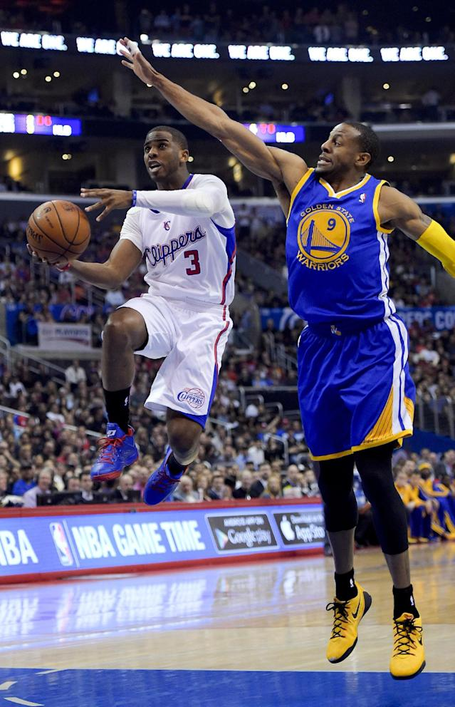 Los Angeles Clippers guard Chris Paul, left, drives past Golden State Warriors forward Andre Iguodala during the first half in Game 5 of an opening-round NBA basketball playoff series, Tuesday, April 29, 2014, in Los Angeles. (AP Photo)