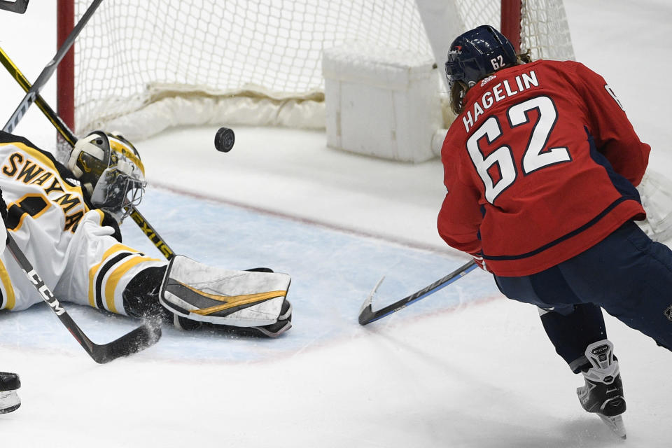 Washington Capitals left wing Carl Hagelin (62) scores a goal past Boston Bruins goaltender Jeremy Swayman (1) during the second period of an NHL hockey game, Tuesday, May 11, 2021, in Washington. (AP Photo/Nick Wass)