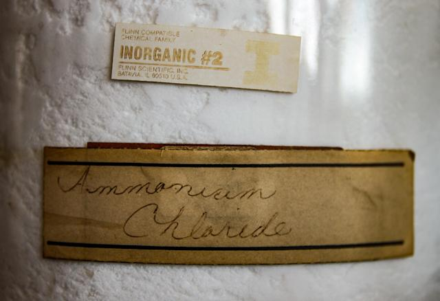 <p>Neat but fading handwriting on a chemical bottle. (Photo: Leland Kent/Caters News) </p>