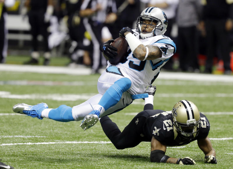 FILE - In this Dec. 3, 2012 file photo, Carolina Panthers' Steve Smith (89) is tripped up by New Orleans Saints' Patrick Robinson (21) after a catch during the second half of an NFL football game in New Orleans. Smith, a free agent, signed a three-year deal with the Baltimore Ravens on Friday, March 14, 2014. (AP Photo/Bill Haber, File)