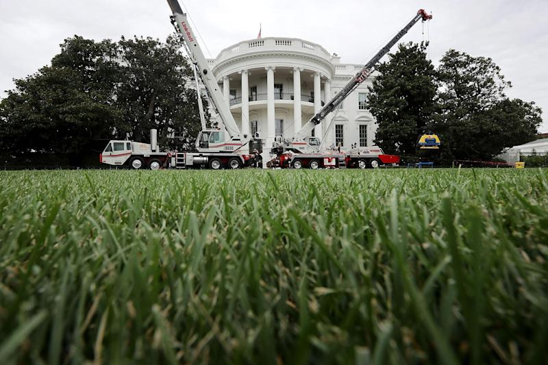 Construction cranes work to repair the South Portico steps as part of a large rennovation project at the White House: Getty Images