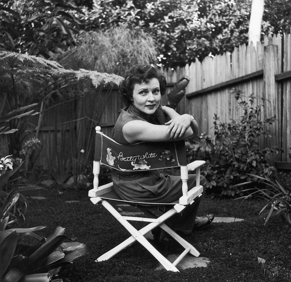 """<p>Here, White is pictured on set in a chair with her name on it. When <em>Life with Elizabeth</em> ended, White then played Vicki Angel on the ABC sitcom <em>Date with the Angels</em>. <a href=""""https://blog.wfmu.org/freeform/2010/04/the-early-betty-white.html"""" rel=""""nofollow noopener"""" target=""""_blank"""" data-ylk=""""slk:White later said"""" class=""""link rapid-noclick-resp"""">White later said</a>, """"I can honestly say that was the only time I have ever wanted to get out of a show.""""</p>"""