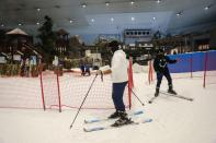 People get ready to ski at Ski Dubai during the reopening of malls, following the outbreak of the coronavirus disease (COVID-19), at Mall of the Emirates in Dubai