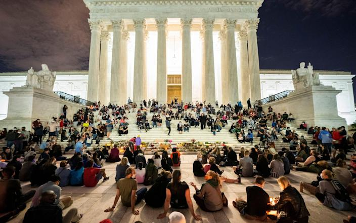 Mourners gather outside the US Supreme Court after Justice Ruth Bader Ginsburg's death - JIM LO SCALZO/EPA-EFE/Shutterstock