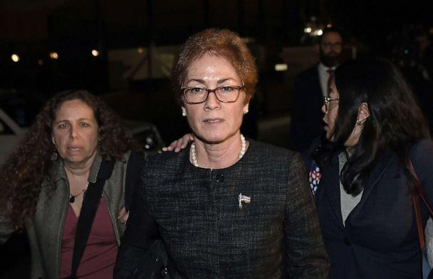 PHOTO: Former US Ambassador to Ukraine Marie Yovanovitch, center, leaves the U.S. Capitol, Oct. 11, 2019, after testifying as part of the ongoing impeachment investigation against President Donald Trump. (Olivier Douliery/AFP via Getty Images)