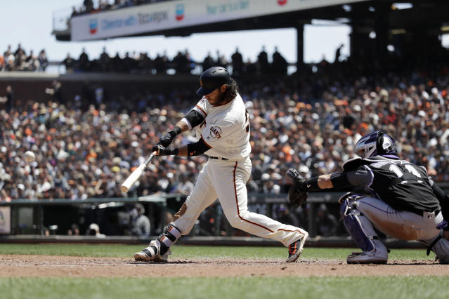San Francisco Giants' Brandon Crawford drives in two runs with a double during the third inning of a baseball game against the Colorado Rockies, Saturday, May 19, 2018, in San Francisco. (AP Photo/Marcio Jose Sanchez)