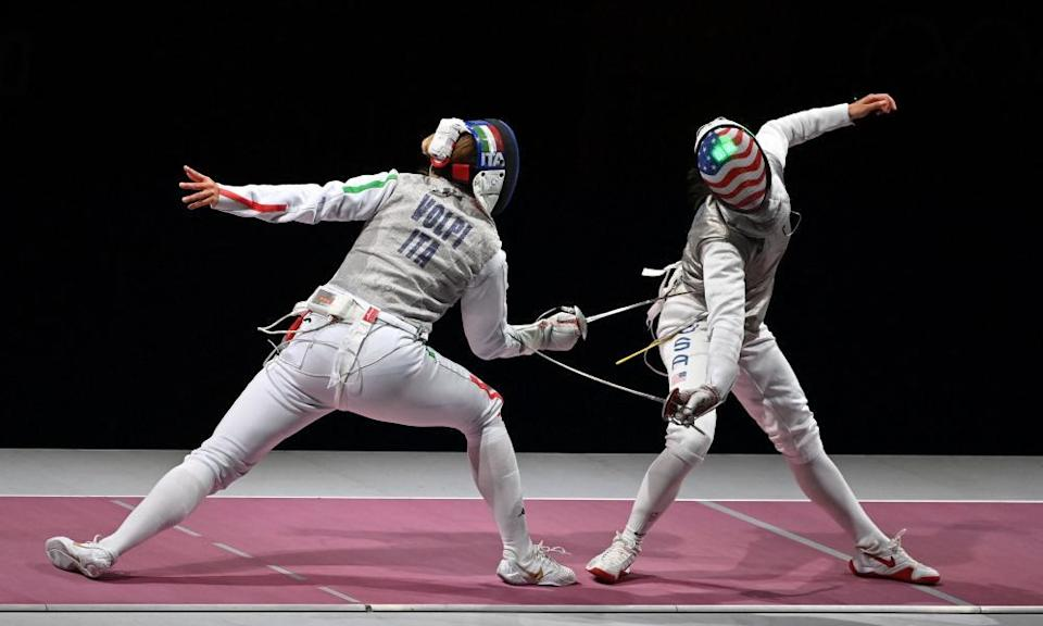 Lee Kiefer (right) competes against Italy's Alice Volpiin the women's team foil event.