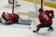 Washington Capitals defenseman Dmitry Orlov (9) clears the puck from in front of goaltender Vitek Vanecek (41) during the first period of an NHL hockey game against the Philadelphia Flyers, Friday, May 7, 2021, in Washington. (AP Photo/Alex Brandon)