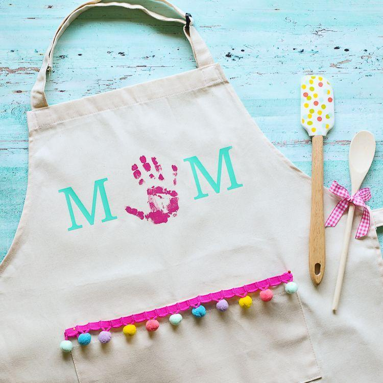 """<p>A simple, easy craft can go a long way. This apron takes little time to put together, but will bring a smile to your face every time you wear it.</p><p><strong>Get the tutorial at <a href=""""https://www.thecraftpatchblog.com/mothers-day-handprint-apron/"""" rel=""""nofollow noopener"""" target=""""_blank"""" data-ylk=""""slk:The Craft Patch"""" class=""""link rapid-noclick-resp"""">The Craft Patch</a>.</strong></p><p><strong><a class=""""link rapid-noclick-resp"""" href=""""https://www.amazon.com/Canvas-Adult-Apron-Pocket-Cotton/dp/B00T8K9Z1S/?tag=syn-yahoo-20&ascsubtag=%5Bartid%7C10050.g.4233%5Bsrc%7Cyahoo-us"""" rel=""""nofollow noopener"""" target=""""_blank"""" data-ylk=""""slk:SHOP CANVAS APRON"""">SHOP CANVAS APRON</a><br></strong></p>"""