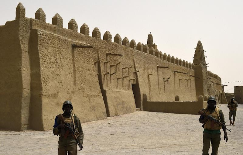 Mali soldiers patrol the Djingareyber Mosque in Timbuktu, on June 6, 2015