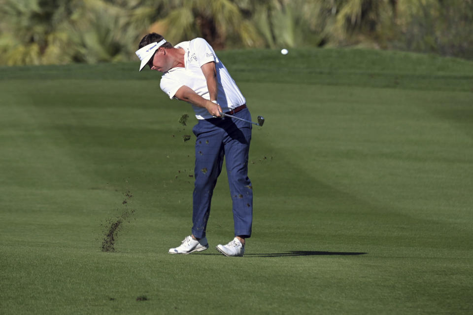 Keith Mitchell hits his second shot on the 18th hole during first round of the CJ Cup golf tournament Thursday, Oct. 14, 2021, in Las Vegas. (AP Photo/David Becker)